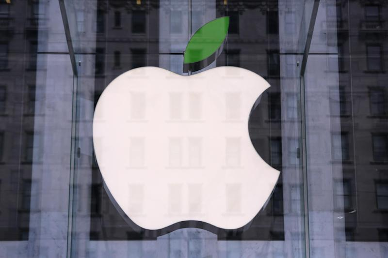 Green leaf adorns the Apple logo on Earth Day at the company's Fifth Avenue store in Midtown Manhattan on April 22, 2014 in New York City