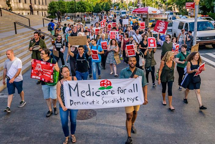 <p>The Socialist Feminists of Democratic Socialists of America (DSA) organized a protest outside of the New York County Republican Office in New York City on July 5, 2017 to tell Republicans that is it despicable and undemocratic that they are trying to ram Trumpcare through the Senate without debate or public hearings. (Photo: Erik McGregor/Pacific Press/LightRocket via Getty Images) </p>
