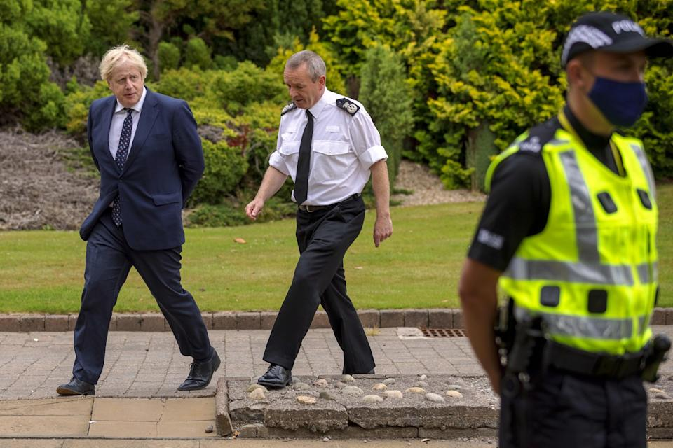 Prime Minister Boris Johnson discussed policing the Cop26 summit in Glasgow when he met Police Scotland Chief Constable Iain Livingstone (James Glossop/The Times/PA)