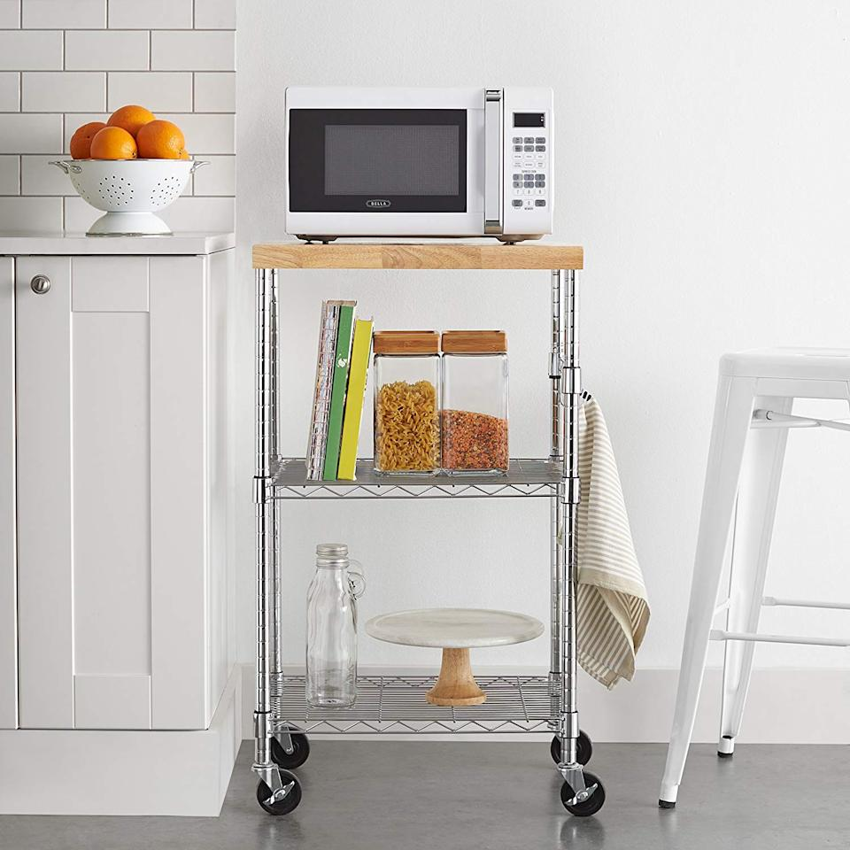 """<h3><a href=""""https://www.amazon.com/AmazonBasics-Microwave-Cart-Wheels-Chrome/dp/B073P2KKXS"""" rel=""""nofollow noopener"""" target=""""_blank"""" data-ylk=""""slk:AmazonBasics Kitchen Rolling Cart"""" class=""""link rapid-noclick-resp"""">AmazonBasics Kitchen Rolling Cart</a></h3><br>A streamlined, rolling kitchen cart for the most compact spaces — this top-rated AmazonBasics' unit comes with a chrome-plated steel frame, removable wooden top, and dual shelving system to keep all your pantry to dining essentials in line and accounted for.<br><br><strong>Amazon Basics</strong> Kitchen Rolling Cart, $, available at <a href=""""https://www.amazon.com/AmazonBasics-Microwave-Cart-Wheels-Chrome/dp/B073P2KKXS"""" rel=""""nofollow noopener"""" target=""""_blank"""" data-ylk=""""slk:Amazon"""" class=""""link rapid-noclick-resp"""">Amazon</a>"""
