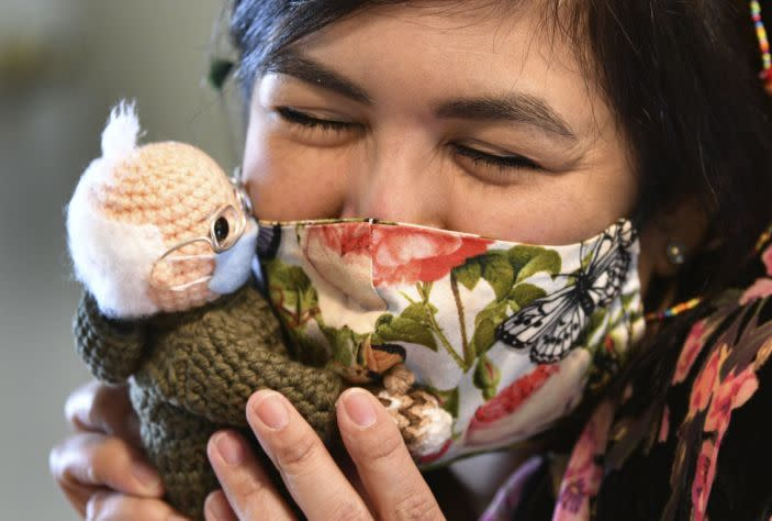 Tobey King, of Corpus Christi, embraces the crochet Bernie Sanders doll that she made and sold on eBay for $20,300 on Tuesday, Jan. 26, 2021. All of the proceeds are being donated to Meals on Wheels.
