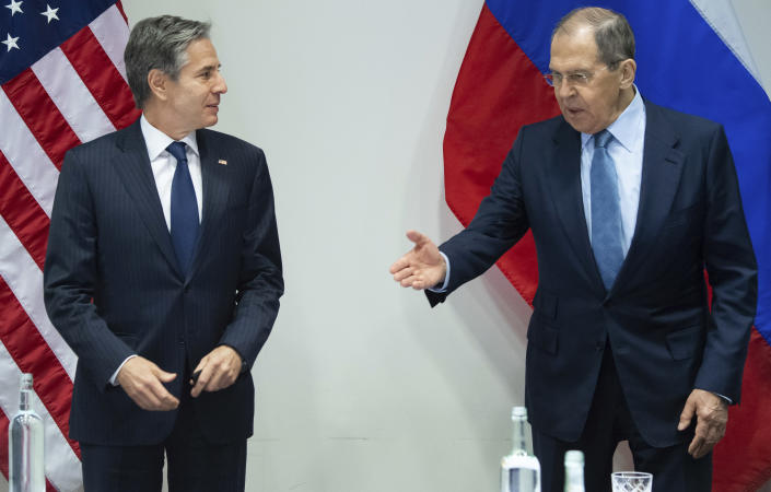 U.S. Secretary of State Antony Blinken, left, and Russian Foreign Minister Sergey Lavrov, right, arrive for a meeting at the Harpa Concert Hall in Reykjavik, Iceland, Wednesday, May 19, 2021, on the sidelines of the Arctic Council Ministerial summit. (Saul Loeb/Pool Photo via AP)