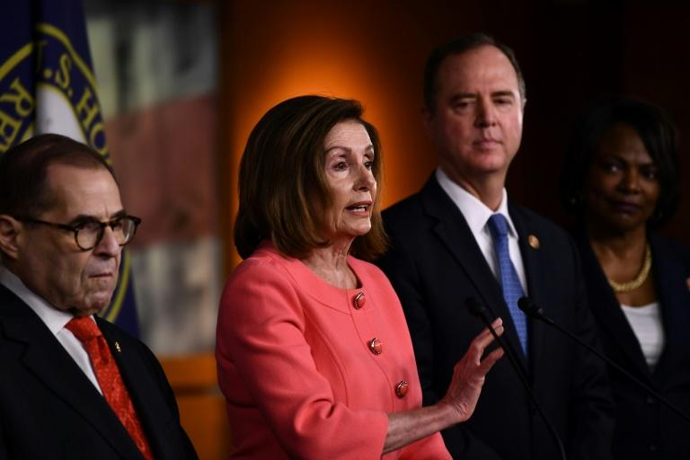 Demcoratic Speaker of the House Nancy Pelosi (C), flanked by represetatives Jerry Nadler (L) and Adam Schiff (R), announces the team of House impeachment managers who will prosecute the case against President Donald Trump in his Senate trial