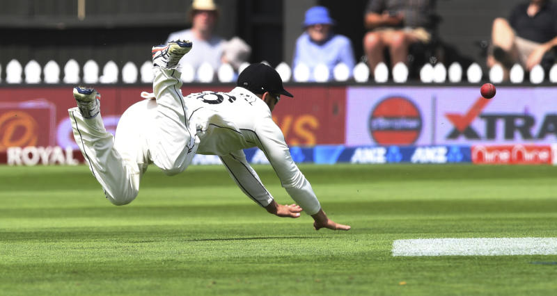 New Zealand's Tom Blundell dives after ball against India during the first cricket test between India and New Zealand at the Basin Reserve in Wellington, New Zealand, Saturday, Feb. 22, 2020. (AP Photo/Ross Setford)