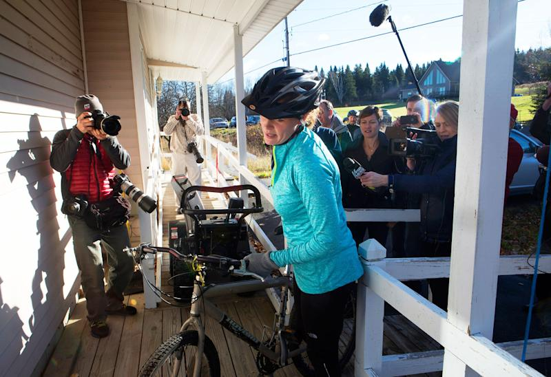 Kaci Hickox returns to her home surrounded by media after going for a bike ride with boyfriend Ted Wilbur in Fort Kent