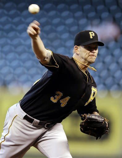 Pittsburgh Pirates pitcher A.J. Burnett (34) throws during the eighth inning of a baseball game against the Houston Astros, Sunday, Sept. 23, 2012, in Houston. (AP Photo/David J. Phillip)