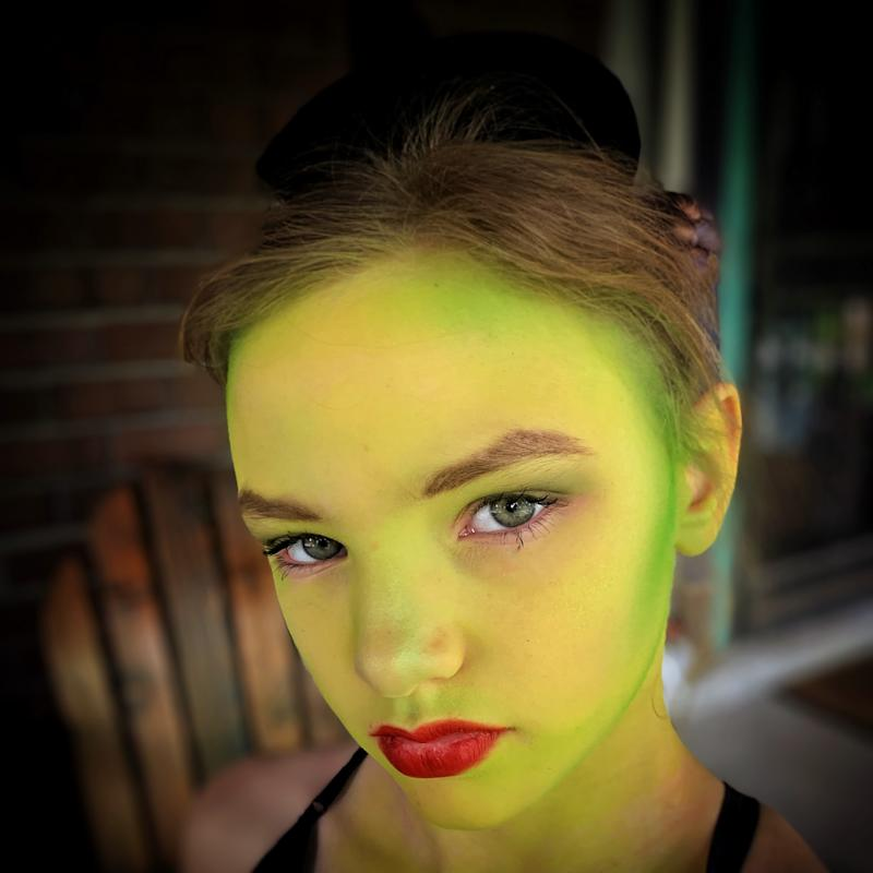 Isabel Perry rocks the 'Wicked' green makeup for her role as Elphaba. (Photo: Courtney Perry).