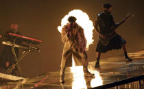 Bad Bunny, center, performs at the Billboard Music Awards, Friday, May 21, 2021, at the Microsoft Theater in Los Angeles. The awards show airs on May 23 with both live and prerecorded segments. (AP Photo/Chris Pizzello)