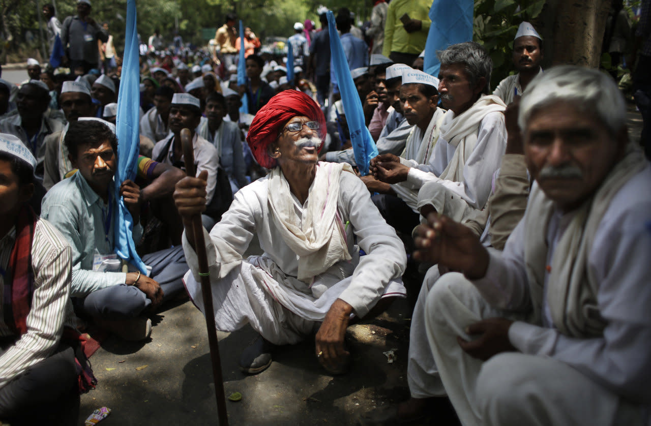 An elderly Indian villager, centre, smokes as he participates in a protest demonstration to highlight the water shortage across the country in New Delhi, India, May 5, 2016. Much of India is reeling under a heat wave and severe drought conditions that have decimated crops, killed livestock and left at least 330 million Indians without enough water for their daily needs. (Altaf Qadri/AP)