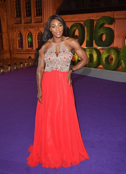 <p>Serena stunned in this red floor-sweeping number at the Wimbledon Winners Ball 2016. <i>[Photo:Karwai Tang/WireImage]</i></p>