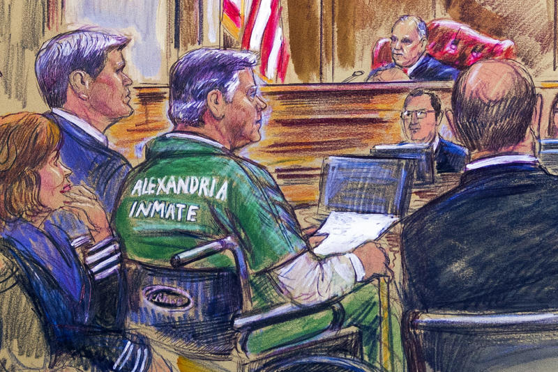 This courtroom sketch depicts former Trump campaign chairman Paul Manafort, center in a wheelchair, during his sentencing hearing in federal court before judge T.S. Ellis III in Alexandria, Va., Thursday, March 7, 2019. Manafort was sentenced to nearly four years in prison for tax and bank fraud related to his work advising Ukrainian politicians, a significant break from sentencing guidelines that called for a 20-year prison term. (Dana Verkouteren via AP)