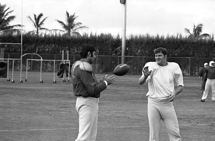 New York Jets quarterback Joe Namath takes a toss from tight end Pete Lammons, right, during a training session in Fort Lauderdale, Fla., Jan. 10, 1969. (AP Photo)