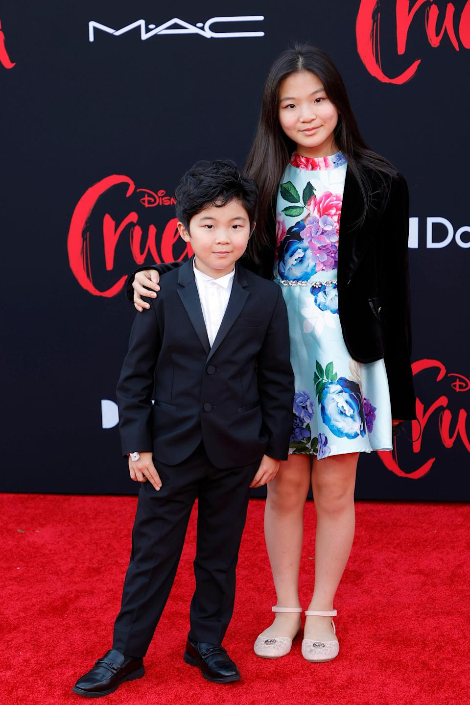 Breakout actor Alan Kim attended the premiere with his sister, actor Alyssa Kim. Alan also got the suit memo. Rocking Gucci, he opted for a simple, sleek black suit and white shirt with pleated details down the front. Alyssa, on the other hand, went for a summery floral dress and a start black blazer.