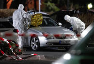 FILE - In this Feb.20, 2020 file photo police forensic officers investigate at the scene after a shooting in central Hanau, Germany. Several people were killed in shootings in the German city of Hanau on Wednesday evening, (AP Photo/Michael Probst,file)