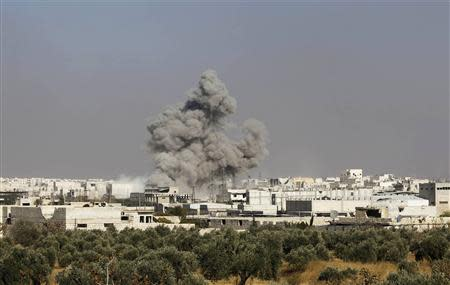 Smoke rises from what activists say was shelling from forces loyal to Syrian President Bashar al-Assad in Aleppo
