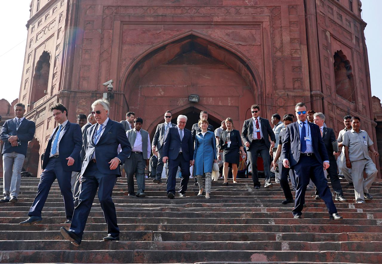 Germany's President Frank-Walter Steinmeier and his wife Elke Buedenbender leave after their visit to the Jama Masjid (Grand Mosque) in the old quarters of Delhi, India, March 23, 2018. REUTERS/Cathal McNaughton