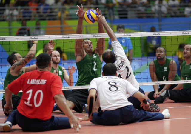 2016 Rio Paralympics - Sitting Volleyball - Men's Bronze Medal Match - Riocentro Pavilion 6 - Rio de Janeiro, Brazil - 18/09/2016. Levi Cesar Gomes (BRA) of Brazil and Mohamed Abouelyazeid (EGY) of Egypt in action. REUTERS/Ueslei Marcelino FOR EDITORIAL USE ONLY. NOT FOR SALE FOR MARKETING OR ADVERTISING CAMPAIGNS.