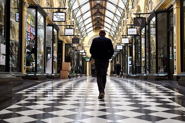 A man walks through a usually bustling shopping arcade in Melbourne as the city re-enters a lockdown after a fresh outbreak of the COVID-19 coronavirus.