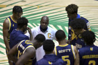 Bryan Spencer, center, head coach of the Carver College talks with his players before their game against Florida International Monday, Dec. 21, 2020, in Miami. (AP Photo/Gaston De Cardenas)