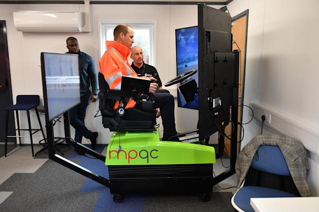 The Duke of Cambridge (left) operating an excavator simulator at the skills park. (Press Association)