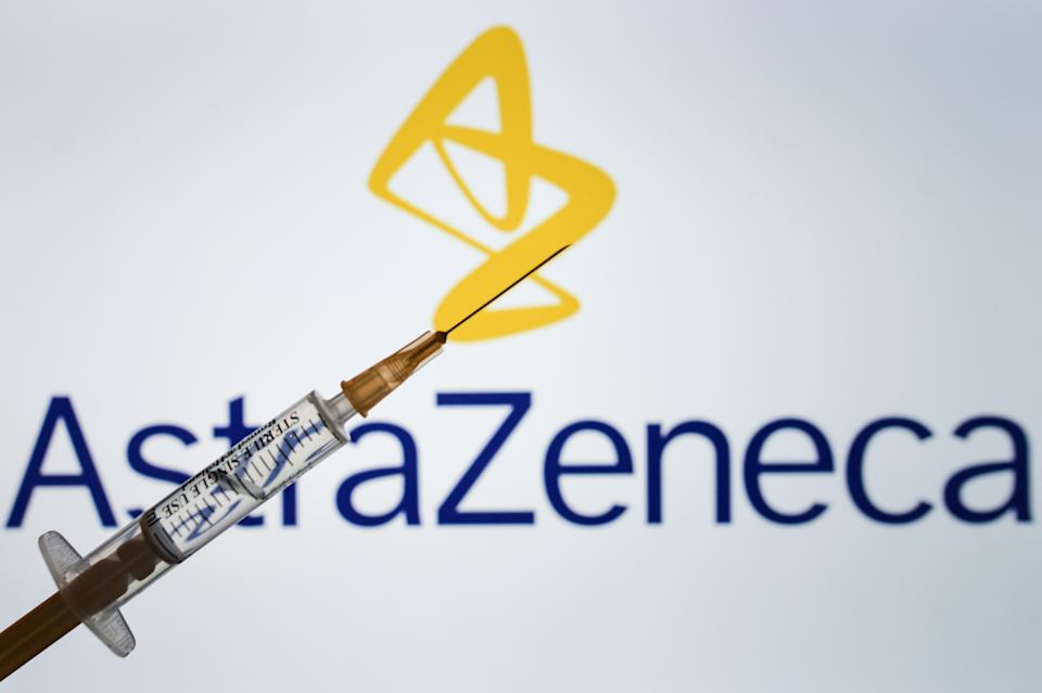 An illustrative image of medical syringes in front of an AstraZeneca logo displayed on a screen. On Tuesday, January 26, 2021, in Dublin, Ireland. (Photo illustration by Artur Widak/NurPhoto via Getty Images)