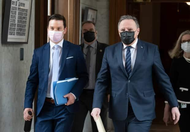 Quebec Premier François Legault, right, and Justice Minister Simon Jolin-Barrette walk to a news conference after tabling a reform of the province's language law on Thursday. (Jacques Boissinot/The Canadian Press - image credit)