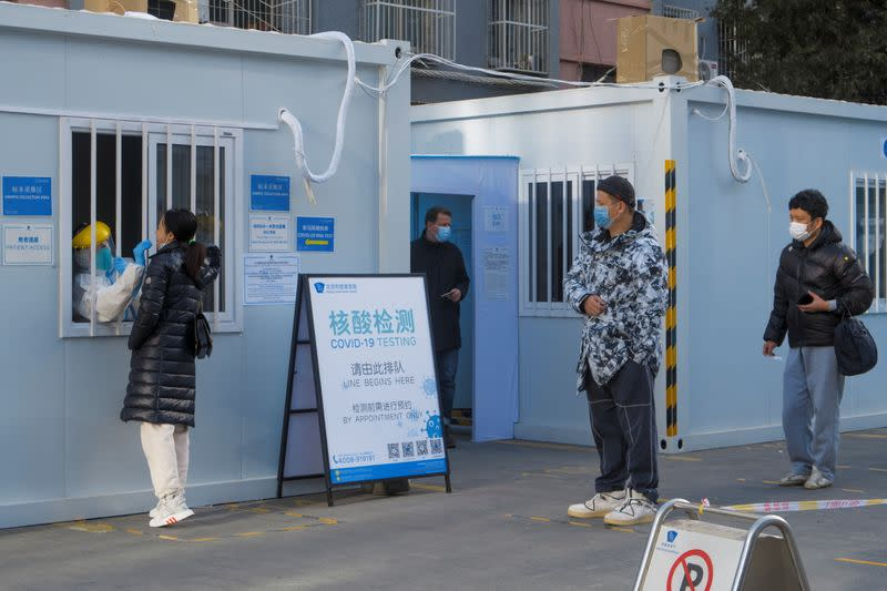 People line up to get their nucleic acid test in the courtyard of a hospital following the outbreak of the coronavirus disease (COVID-19) in Beijing