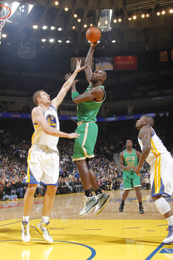 OAKLAND, CA - MARCH 14: Kevin Garnett #5 of the Boston Celtics attempts a hook shot over David Lee #10 of the Golden State Warriors on March 14, 2012 at Oracle Arena in Oakland, California. (Photo by Rocky Widner/NBAE via Getty Images)