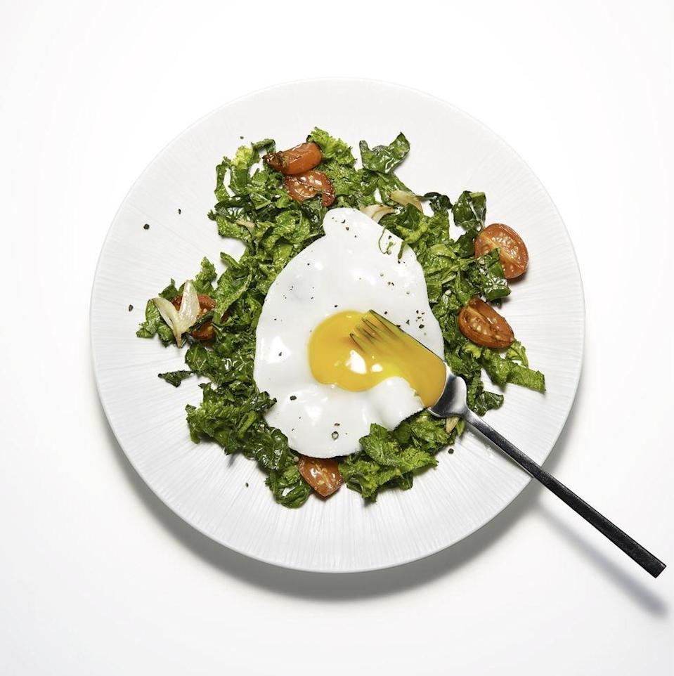 """<p>You know you'd order this for brunch, so why not whip it up yourself? Tomatoes and your greens of choice make a healthy bed for a perfectly cooked egg. (Bonus: It's <a href=""""https://www.prevention.com/food-nutrition/a20483336/keto-diet-facts/"""" rel=""""nofollow noopener"""" target=""""_blank"""" data-ylk=""""slk:also keto-friendly"""" class=""""link rapid-noclick-resp"""">also keto-friendly</a>.)</p><p><a href=""""https://www.prevention.com/food-nutrition/recipes/a20517776/sunny-side-up-eggs-on-garlicky-greens/"""" rel=""""nofollow noopener"""" target=""""_blank"""" data-ylk=""""slk:Get the recipe from Prevention »"""" class=""""link rapid-noclick-resp""""><strong><em>Get the recipe from Prevention »</em></strong></a></p>"""