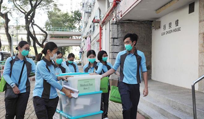 Staff from the Centre for Health Protection at the Department of Health arrive at Luk Chuen House on Thursday. Photo: Xiaomei Chen