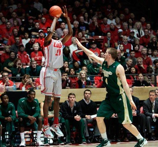 New Mexico's Tony Snell shoots and scores three of his game-high 23 points against Colorado State's Pierce Hornung in the first half of their NCAA college basketball game in Albuquerque, N.M., Wednesday, Jan. 23, 2013. New Mexico won 66-61. (AP Photo/Eric Draper)