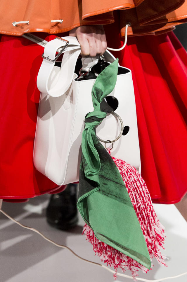 <p><i>White bucket bag with green scarf attached from the SS18 Calvin Klein collection. (Photo: ImaxTree) </i></p>