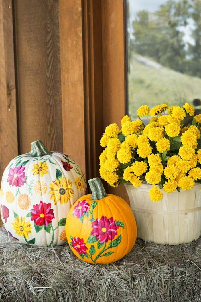"""<p>The best thing about these floral painted pumpkins is that they don't need to be watered! 😂 Paint a few blooms freehand, then prop them next to your outdoor blooms.</p><p><a class=""""link rapid-noclick-resp"""" href=""""https://go.redirectingat.com?id=74968X1596630&url=https%3A%2F%2Fwww.walmart.com%2Fsearch%2F%3Fquery%3Dcraft%2Bpaint&sref=https%3A%2F%2Fwww.thepioneerwoman.com%2Fhome-lifestyle%2Fdecorating-ideas%2Fg36732301%2Foutdoor-fall-decorations%2F"""" rel=""""nofollow noopener"""" target=""""_blank"""" data-ylk=""""slk:SHOP CRAFT PAINT"""">SHOP CRAFT PAINT</a></p>"""