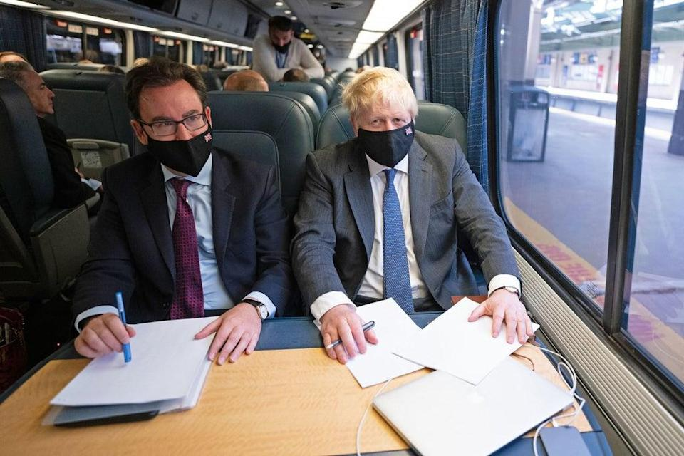 Prime Minister Boris Johnson spoke to reporters about Universal Credit while travelling on a train in the US (Stefan Rousseau/PA) (PA Wire)