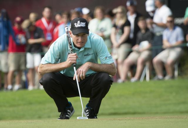 Jim Furyk checks his line on the 17th green during second round play at the Canadian Open golf championship Friday, July 25, 2014 in Montreal. (AP Photo/The Canadian Press, Paul Chiasson)