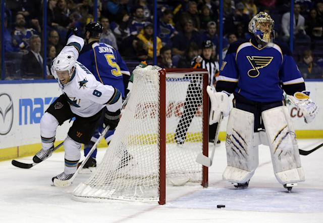 San Jose Sharks' Joe Pavelski, left, celebrates after scoring past St. Louis Blues goalie Jaroslav Halak, right, of Slovakia, during the first period of an NHL hockey game Tuesday, Dec. 17, 2013, in St. Louis. (AP Photo/Jeff Roberson)