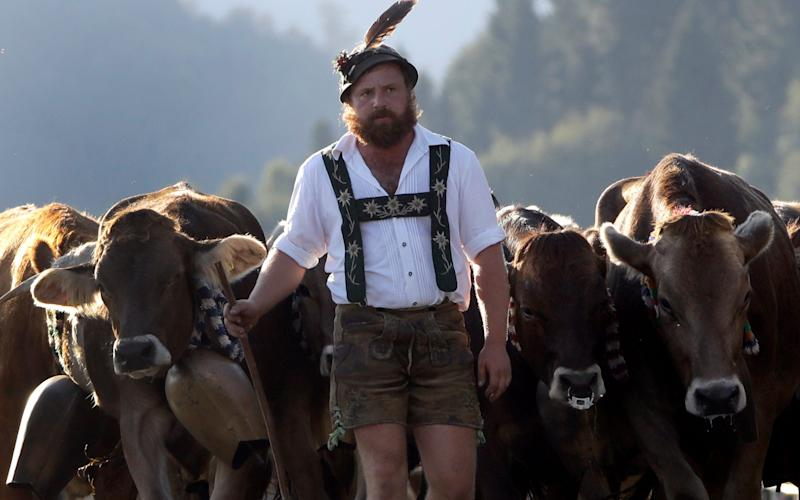 A Bavarian herdsman in traditional dress - Credit: AP Photo/Matthias Schrader