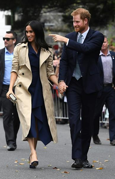 Thousands of royal fans in Melbourne waited in the rain for the couple, who were delayed by traffic