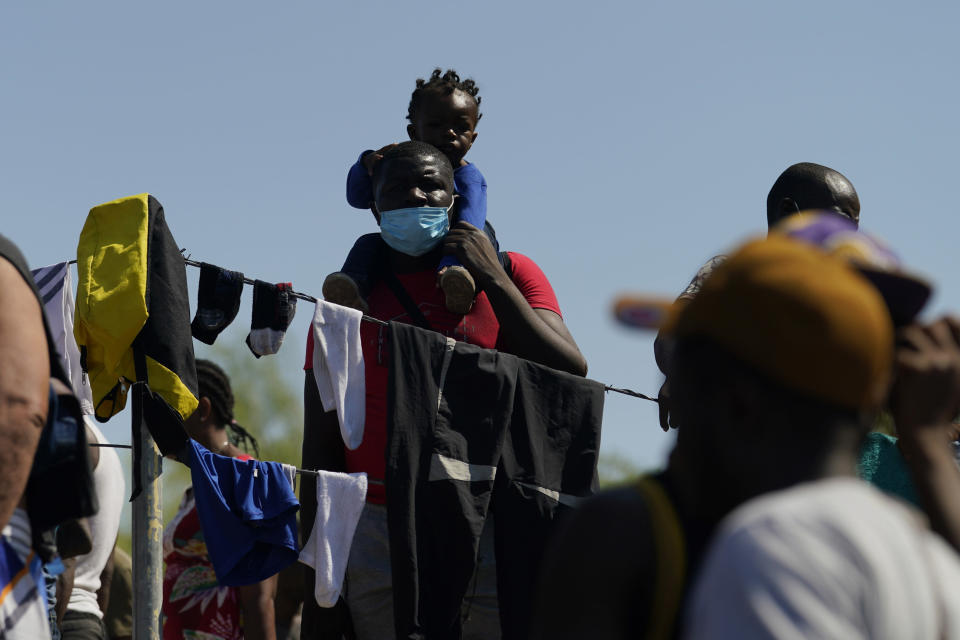 Migrants in a make-shift camp after crossing the Rio Grande to the United States from Mexico, Friday, Sept. 17, 2021, in Del Rio, Texas. Thousands of Haitian migrants have assembled under and around a bridge in Del Rio presenting the Biden administration with a fresh and immediate challenge as it tries to manage large numbers of asylum-seekers who have been reaching U.S. soil. (AP Photo/Eric Gay)