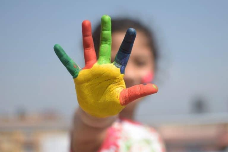 Child's hand painted in different colours