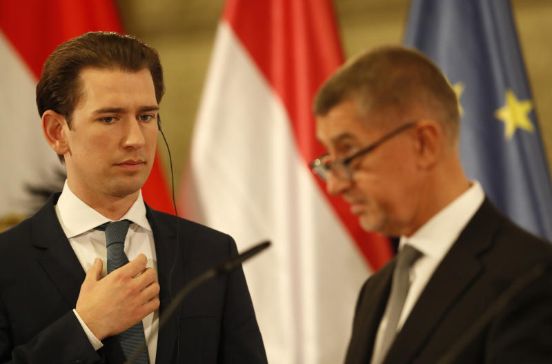Austria's Chancellor Sebastian Kurz, left, listens to Czech Republic's Prime Minister Andrej Babis during their joint press conference with V4 Prime Ministers after their meeting at the National Museum in Prague, Czech Republic, Thursday, Jan. 16, 2020. (AP Photo/Petr David Josek)