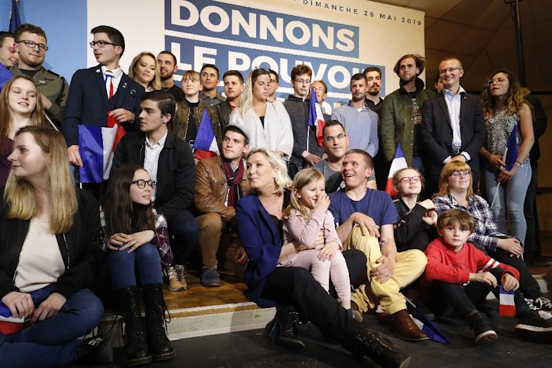 French far-right RN party leader Marine Le Pen (C) on the campaign trail vowed to appeal  her case on misused EU parliament funds to the European Court of Human Rights