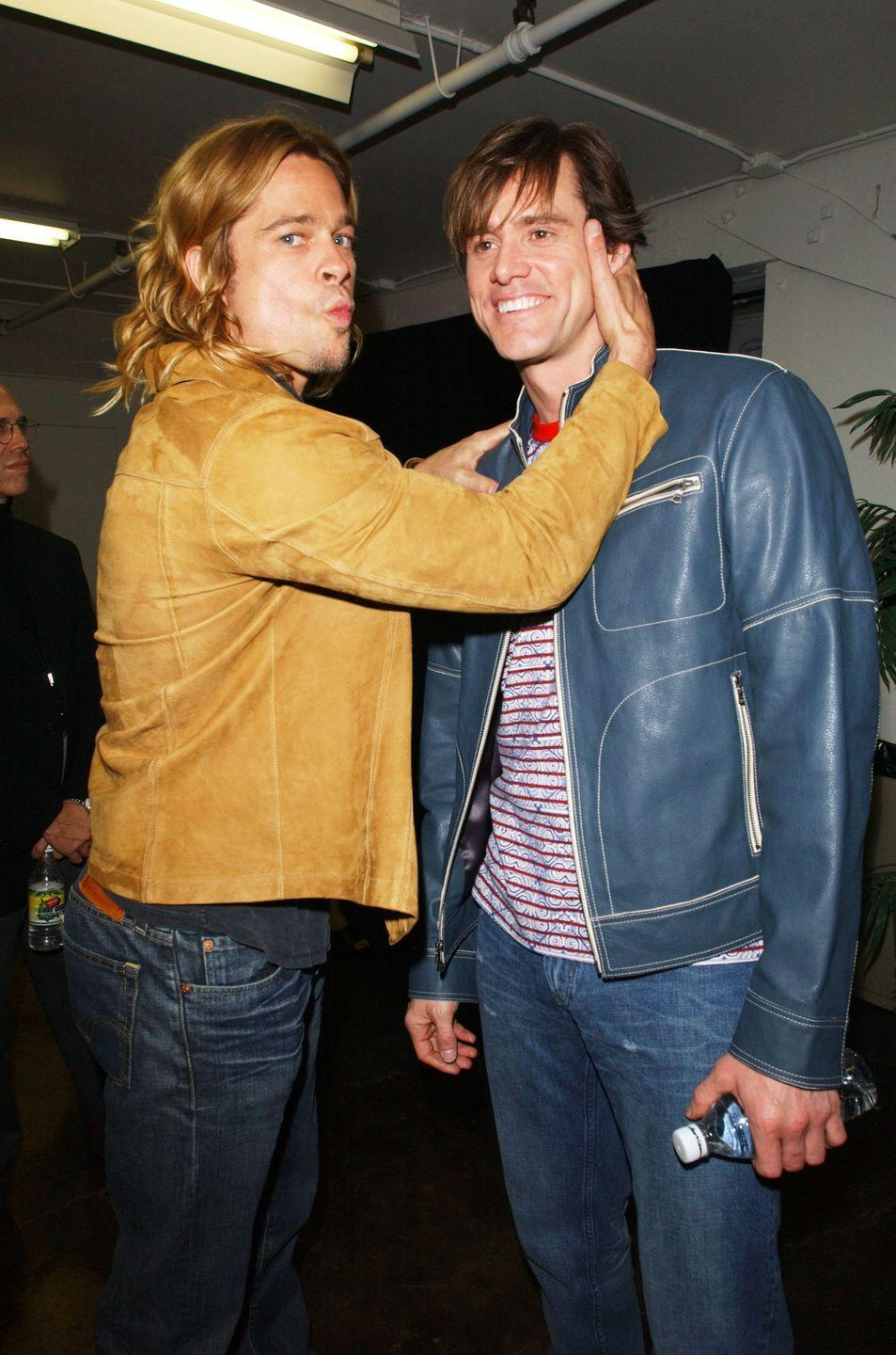 "<p>Pitt poses with Jim Carrey backstage at the Nickelodeon Kids' Choice Awards in April 2003. Carrey said on <a href=""https://www.smh.com.au/entertainment/celebrity/jim-carrey-blasts-tom-cruise-20091111-i89a.html"" rel=""nofollow noopener"" target=""_blank"" data-ylk=""slk:Chelsea Lately"" class=""link rapid-noclick-resp""><em>Chelsea Lately</em></a> in 2009 that Pitt ""can do no wrong.""</p>"