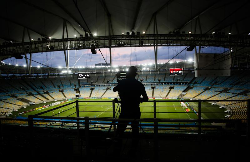 RIO DE JANEIRO, BRAZIL - MARCH 14: A camera crew member works in an empty stadium during a match between Flamengo and Potuguesa as part of the Rio State Championship 2020, to be played behind closed doors at Maracana Stadium on March 14, 2020 in Rio de Janeiro, Brazil. The Government of the State of Rio de Janeiro issued a list of new guidelines to help prevent the spread of the coronavirus (COVID-19) which included the matches must be played behind closed doors and no public. According to the Ministry of Health, as of Friday March 13th, Brazil had 98 confirmed cases of coronavirus. (Photo by Bruna Prado/Getty Images)