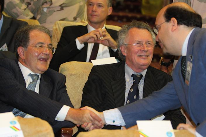 Former Italian Premier Romano Prodi, left, is greeted by an unidentified man as he attends meetings in Bamako, Mali, where he is serving as the United Nations special envoy to the Sahel, Friday, Apr. 19, 2013. Italy's Parliament failed again Friday in the third round to elect a successor to President Giorgio Napolitano. The center-left leader Friday proposed former Premier Prodi for the post, but Silvio Berlusconi's center-right quickly made clear its opposition to Prodi.(AP Photo/Harouna Traore)