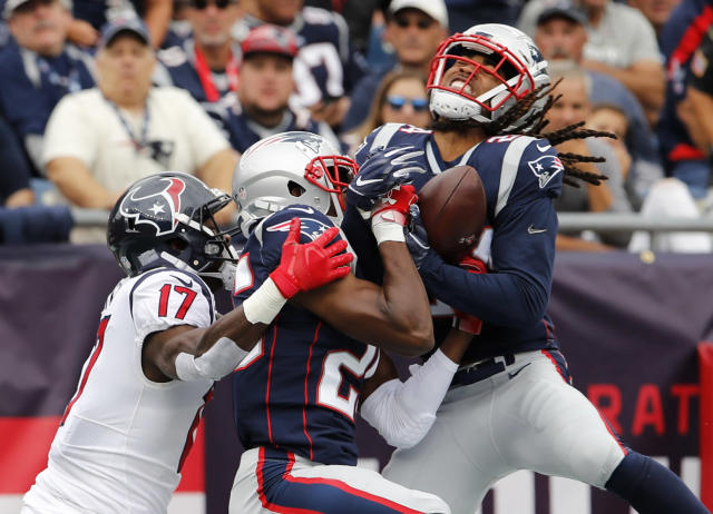 <p>New England Patriots cornerback Stephon Gilmore (24) intercepts an end zone pass with help from teammate defensive back Eric Rowe (25) intended for Houston Texans wide receiver Vyncint Smith (17) in the second quarter at Gillette Stadium. Mandatory Credit: David Butler II-USA TODAY Sports </p>