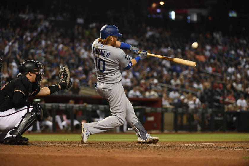 The Dodgers' Justin Turner hits a two-run homer during the seventh inning July 31, 2021, in Phoenix.