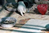 A worker restores a mosaic floor at an ancient church in the small Jordanian town of Rihab