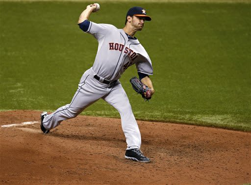 Houston Astros starting pitcher Jarred Cosart throws during the sixth inning of a baseball game against the Tampa Bay Rays, Friday, July 12, 2013, in St. Petersburg, Fla. (AP Photo/Mike Carlson)