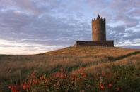 """<p>This 14th-century tower has views of the County Clare rolling hills. You can even <a href=""""https://seaview-doolin.ie/doolin-castles/index.php"""" rel=""""nofollow noopener"""" target=""""_blank"""" data-ylk=""""slk:stay the night"""" class=""""link rapid-noclick-resp"""">stay the night</a> at the castle, making it quite possibly one of the coolest bed & breakfasts in the world. Fin.</p>"""